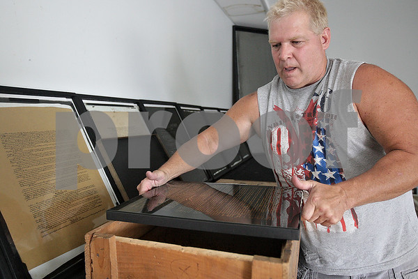 Monica Maschak - mmaschak@shawmedia.com<br /> A year and a half ago, Ken Foss (pictured here) and Jeff Johnson made a discovery of the original lithograph plates used to reproduce the Constitution of the United States and the Declaration of Independence made and once used by Theodore Ohman. The items were found in crates in a warehouse owned by Johnson. Among the plates were also 11 thousand copies of the Constitution and 100 copies of the Declaration. 2013 marks the 226th year of the Constitution.