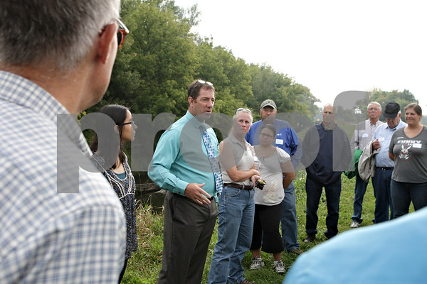 Rob Winner – rwinner@shawmedia.com<br /> <br /> Sycamore High School biology teacher Scott Horlock (third from left) speaks to a group during a watershed tour along the Kishwaukee River on Route 64 just east of Old State Road in Sycamore on Thursday, Sept. 19, 2013.