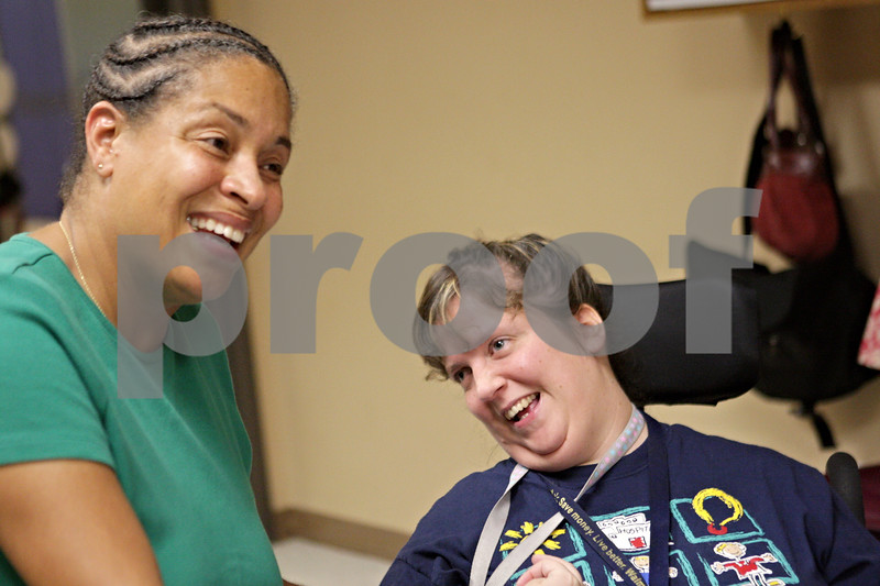 Rob Winner – rwinner@shawmedia.com<br /> <br /> Sharon Wells (left) shares a laugh with Allison Stahl during the open house event celebrating Opportunity House's 50th anniversary on Thursday, Sept. 19, 2013, in Sycamore. Wells went to nursing school with Stahl's mother.