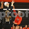 Monica Maschak - mmaschak@shawmedia.com<br /> Courtney Wagner spikes the ball onto the Spartans court in the first of two sets between DeKalb and Sycamore on Tuesday, September 17, 2013. DeKalb won both sets.