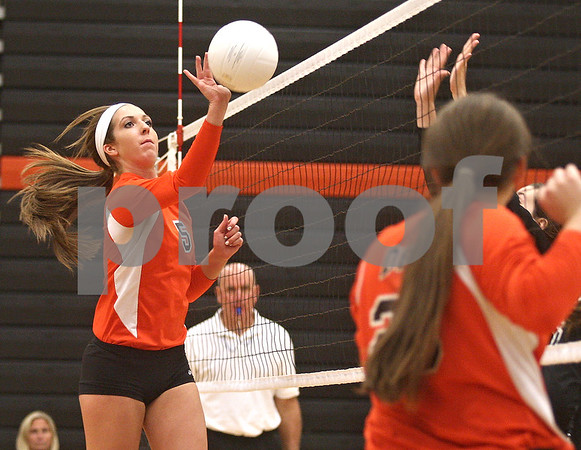 Monica Maschak - mmaschak@shawmedia.com<br /> Heather Bemis taps the ball over the net in the second of two sets between DeKalb and Sycamore on Tuesday, September 17, 2013. DeKalb won both sets.