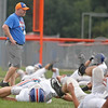 Monica Maschak - mmaschak@shawmedia.com<br /> Coach Travis Frederick monitors his team during stretches before a Cogs football practice on Tuesday, September 17, 2013.