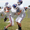 Monica Maschak - mmaschak@shawmedia.com<br /> Tyeler L'Huillier practices a formation tackle on Matt Wojdyla in a defense drill during a Cogs football practice on Tuesday, September 17, 2013.
