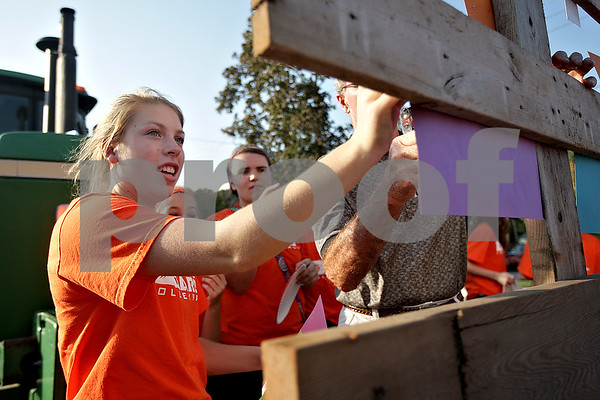 Monica Maschak - mmaschak@shawmedia.com<br /> Junior Kate Hickey decorates the girls' volleyball float before DeKalb's homecoming parade on Thursday, September 19, 2013.