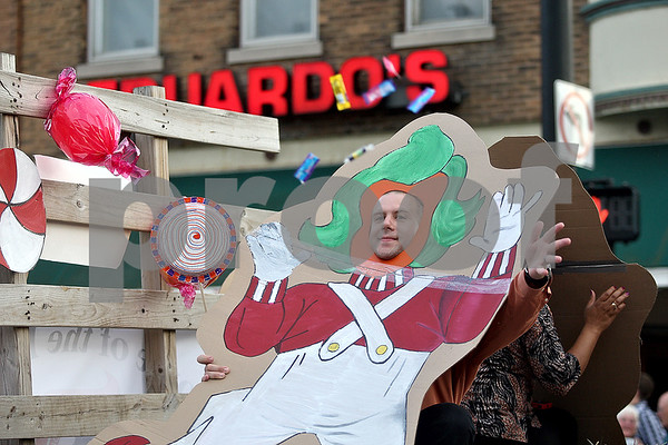 Monica Maschak - mmaschak@shawmedia.com<br /> DeKalb High School Administrators tossed candy to parade-goers from behind Oompa Loompa cut-outs during DeKalb's homecoming parade on Thursday, September 19, 2013.