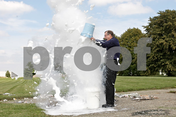 Rob Winner – rwinner@shawmedia.com<br /> <br /> Jerry Zimmerman of Fermilab, or Mr. Freeze, dumps a bucket of liquid nitrogen into another bucket of soap during a demonstration at St. Mary Catholic School in DeKalb on Tuesday, Sept. 17, 2013.
