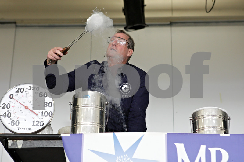 Rob Winner – rwinner@shawmedia.com<br /> <br /> Jerry Zimmerman of Fermilab, or Mr. Freeze, removes a balloon from a canister of liquid nitrogen during a demonstration at St. Mary Catholic School in DeKalb on Tuesday, Sept. 17, 2013.