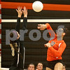 Monica Maschak - mmaschak@shawmedia.com<br /> Alexis Hammond kills the ball in the first of two sets between DeKalb and Sycamore on Tuesday, September 17, 2013. DeKalb won both sets.
