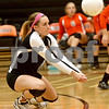 Monica Maschak - mmaschak@shawmedia.com<br /> Nicole Schladt digs deep in the second of two sets between DeKalb and Sycamore on Tuesday, September 17, 2013. DeKalb won both sets.