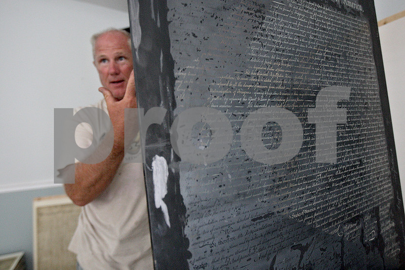 Monica Maschak - mmaschak@shawmedia.com<br /> A year and a half ago, Ken Foss and Jeff Johnson (pictured here) made a discovery of the original lithograph plates used to reproduce the Constitution of the United States and the Declaration of Independence made and once used by Theodore Ohman. The items were found in crates in a warehouse owned by Johnson. Among the plates were also 11 thousand copies of the Constitution and 100 copies of the Declaration. 2013 marks the 226th year of the Constitution.