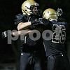 Rob Winner – rwinner@shawmedia.com<br /> <br /> Sycamore's Ben Niemann (left) celebrates his touchdown reception with Jake Swick in the second quarter during a game against Geneseo in Sycamore, Ill., Friday, Sept. 20, 2013.