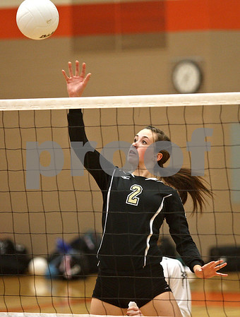 Monica Maschak - mmaschak@shawmedia.com<br /> Emily Young sends the ball over the net in the second of two sets between DeKalb and Sycamore on Tuesday, September 17, 2013. DeKalb won both sets.