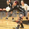 Monica Maschak - mmaschak@shawmedia.com<br /> Mallory Wolf plays the ball to the center in the second of two sets between DeKalb and Sycamore on Tuesday, September 17, 2013. DeKalb won both sets.