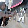 Monica Maschak - mmaschak@shawmedia.com<br /> Freshman Daisha Brooks tapes Oompa Loompas to the Black Student Union's float prior to  DeKalb's homecoming parade on Thursday, September 19, 2013.