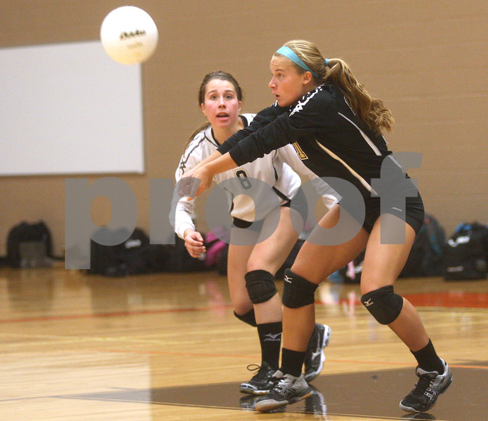 Monica Maschak - mmaschak@shawmedia.com<br /> Alyssa Maillefer bumps the ball in the second of two sets between DeKalb and Sycamore on Tuesday, September 17, 2013. DeKalb won both sets.