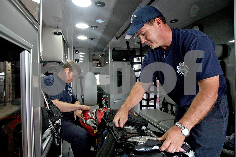 Monica Maschak - mmaschak@shawmedia.com<br /> Fire fighter paramedics Noah Millard (left) and Dave DeLille prepare medical bags inside a new ambulance at DeKalb Fire Station 1 on Friday, September 6, 2013.