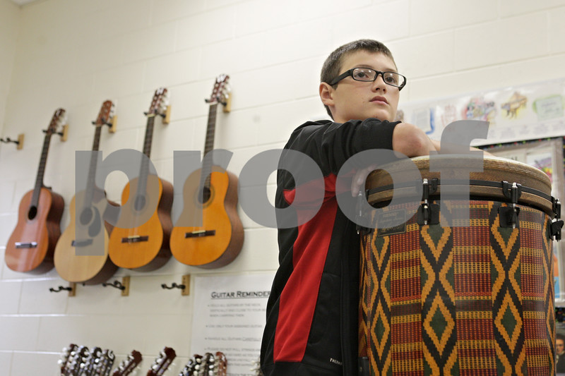 Rob Winner – rwinner@shawmedia.com<br /> <br /> Chase Johnson, 11, waits his turn to play a drum during music class at Clinton Rosette Middle School in DeKalb on Tuesday, Sept. 17, 2013. All general music classes are set to be cut from middle schools in DeKalb after this academic school year.