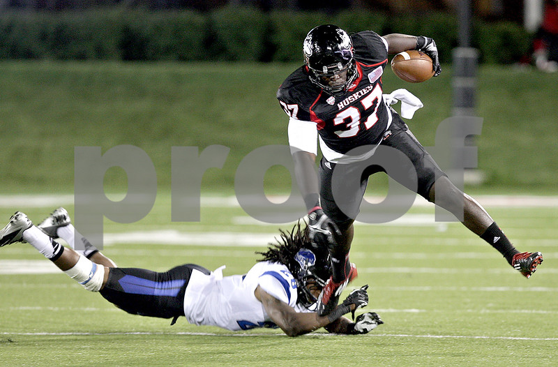Monica Maschak - mmaschak@shawmedia.com<br /> Tight end Desroy Maxwell escapes a tackle in the third quarter of Northern Illinois hosting Eastern Illinois on Saturday, September 21, 2013. The Huskies won 43-39.