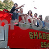 Monica Maschak - mmaschak@shawmedia.com<br /> The Indian Creek Girls Volleyball team tosses candy from atop a fire engine during the Indian Creek Homecoming Parade in Waterman on Saturday, September 28, 2013.