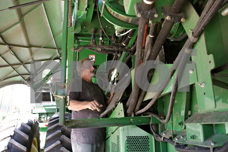 Rob Winner – rwinner@shawmedia.com<br /> <br /> Terry Nelson prepares a combine for corn harvesting at Johnson Farms in DeKalb on Tuesday, Sept. 24, 2013. Nelson has been working for Johnson Farms for a combined 27 years.