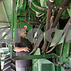 Rob Winner – rwinner@shawmedia.com<br /> <br /> Terry Nelson prepares a combine for corn harvesting at Johnson Farms in DeKalb on Tuesday, Sept. 24, 2013. Nelson has been working for Johnson Farms for a combined 27 years.