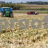 Erik Anderson - For the Daily Chronicle<br /> Mothers stand outside of a pickup truck waiting for a personalized ride in a combine during the Illinois Farm Families' Field Mom program held at Larson Farms in Maple Park on Saturday, September 21, 2013.