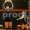 Monica Maschak - mmaschak@shawmedia.com<br /> Madison Lord sets backward to Heather Bemis in the first of two sets against Yorkville on Thursday, September 26, 2013. DeKalb won both sets.