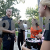 Monica Maschak - mmaschak@shawmedia.com<br /> Community Relations Officer Chad McNett chats with members of Celebrate My Drive prior to the DeKalb Homecoming parade on Thursday, September 19, 2013. The student group promotes and encourages students to be safe drivers.
