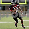 Monica Maschak - mmaschak@shawmedia.com<br /> Wide receiver Tommylee Lewis carries the ball in the first quarter of Northern Illinois hosting Eastern Illinois on Saturday, September 21, 2013. The Huskies won 43-39.
