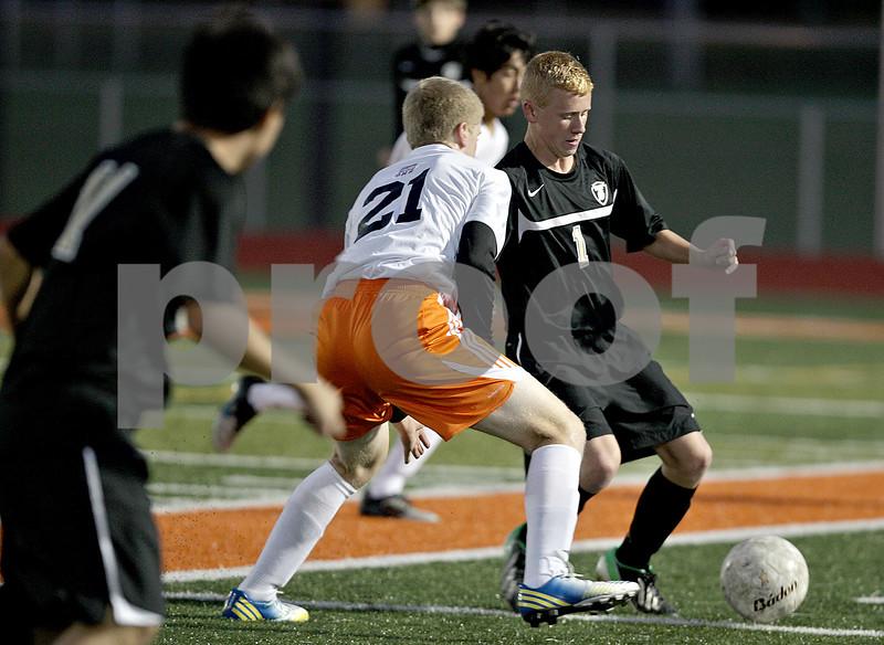 Monica Maschak - mmaschak@shawmedia.com<br /> Sycamore's Adam Millburg proceeds past DeKalb's Owen Smith in the first half of the Sycamore soccer match at DeKalb High School on Tuesday, September 24, 2013. DeKalb won 7-0.