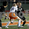 Monica Maschak - mmaschak@shawmedia.com<br /> Sycamore's Adam Millburg proceeds past DeKalb's Owen Smith in the first half of the Sycamore soccer match at DeKalb High School on Tuesday, September 24, 2013. DeKalb won 7-0.