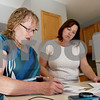 Monica Maschak - mmaschak@shawmedia.com<br /> Real Estate Investor Lindy Arnett (right) discusses the brochure and lease requirements with Managing Broker Alison Rosenow at a DeKalb home on Thursday, September 26, 2013.