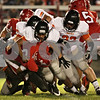 Rob Winner – rwinner@shawmedia.com<br /> <br /> Streator running back Nick Harcar (8) is taken to the turf by DeKalb defenders in the first quarter in Streator, Ill., Friday, Sept. 27, 2013.