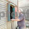 Rob Winner – rwinner@shawmedia.com<br /> <br /> Terry Nelson checks a grain storage bin at Johnson Farms in DeKalb on Tuesday, Sept. 24, 2013.
