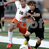 Monica Maschak - mmaschak@shawmedia.com<br /> Sycamore's Jarrett Brown takes on DeKalb's Jared Smith for possession of the ball in the first half of the Sycamore soccer match at DeKalb High School on Tuesday, September 24, 2013. DeKalb won 7-0.