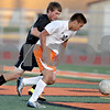 Monica Maschak - mmaschak@shawmedia.com<br /> Sean Woodford dribbles his way to a successful second goal for DeKalb in the first half of the Sycamore soccer match at DeKalb High School on Tuesday, September 24, 2013. DeKalb won 7-0.