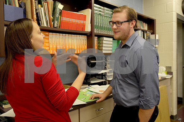 Monica Maschak - mmaschak@shawmedia.com<br /> Eighth grade english and literature teacher Jenny Tekiela (right) and student teacher Jacob Keene debrief after school and discuss lesson plans at Sycamore Middle School on Friday, September 27, 2013. Keene is a senior English student at Northern Illinois University who wishes to get his teaching license and have his own classroom after graduation.