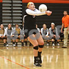 Monica Maschak - mmaschak@shawmedia.com<br /> Madison Lord makes a pass in the first of two sets against Yorkville on Thursday, September 26, 2013. DeKalb won both sets.