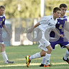 Rob Winner – rwinner@shawmedia.com<br /> <br /> Hiawatha's PJ Nordgren (2) and Serena's Chad Rogers (5) chase after a ball during the first half in Kirkland, Ill., Monday, Sept. 23, 2013.