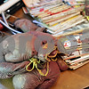 Rob Winner – rwinner@shawmedia.com<br /> <br /> Boxing gloves that belonged to Carl Wallin are seen next to boxing magazines during an estate sale on Thursday morning in Sycamore.<br /> <br /> Thursday, Sept. 26, 2013