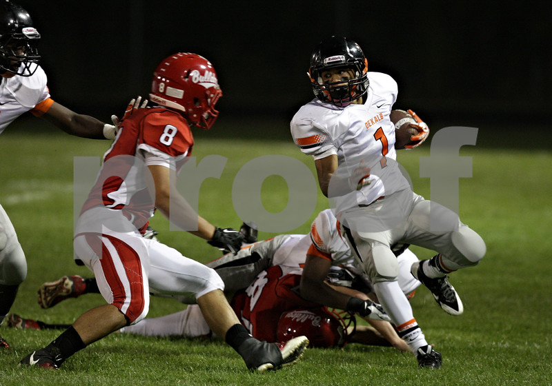 Rob Winner – rwinner@shawmedia.com<br /> <br /> DeKalb's Tony Tate (1) carries the ball after the opening kickoff in the first quarter in Streator, Ill., Friday, Sept. 27, 2013.