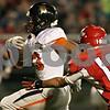 Rob Winner – rwinner@shawmedia.com<br /> <br /> DeKalb running back Dre Brown carries the ball for a 14-yard touchdown run during the first quarter in Streator, Ill., Friday, Sept. 27, 2013.