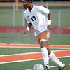 Monica Maschak - mmaschak@shawmedia.com<br /> Akim Suraji looks to pass in the first half of the Sycamore soccer match at DeKalb High School on Tuesday, September 24, 2013. DeKalb won 7-0.