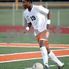 Monica Maschak - mmaschak@shawmedia.com<br /> Akim Suraji looks to pass in the first half of the Sycamore soccer match at DeKalb High School on Tuesday, September 24, 2013. DeKalb won 7-0.