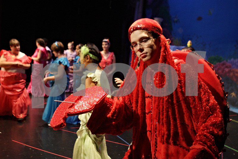 "Rob Winner – rwinner@shawmedia.com<br /> <br /> Jacob Ihm, 15, playing Sebastian is seen on stage with cast members during rehearsal for the Penguin Project's performance of Disney's ""The Little Mermaid Jr"" at Sycamore High School on Monday, Sept. 23, 2013."