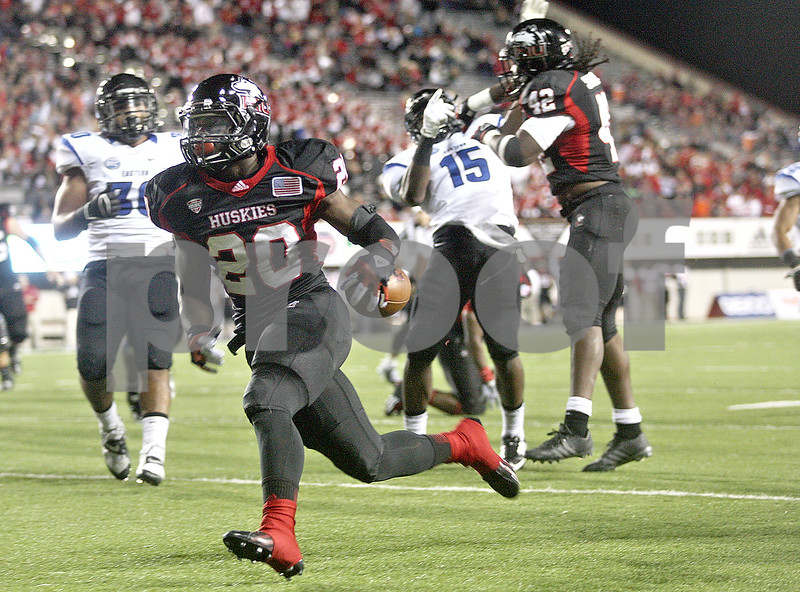 Monica Maschak - mmaschak@shawmedia.com<br /> Running back Keith Harris Jr. crosses into the end zone for a touchdown in the third quarter of Northern Illinois hosting Eastern Illinois on Saturday, September 21, 2013. The Huskies won 43-39.
