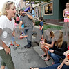 Monica Maschak - mmaschak@shawmedia.com<br /> Tricia Maxwell hands out Celebrate My Drive fliers and business cards during the DeKalb Homecoming parade on Thursday, September 19, 2013. The student group promotes and encourages students to be safe drivers.