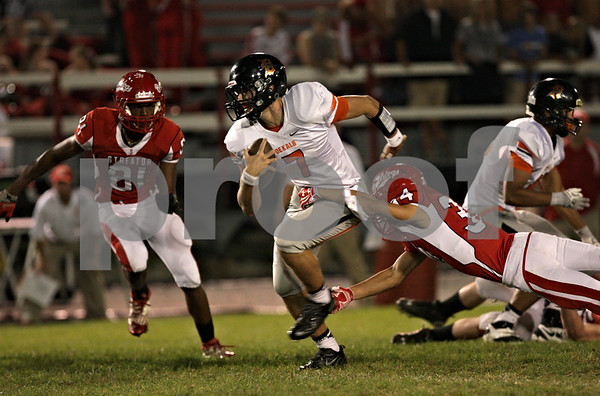 Rob Winner – rwinner@shawmedia.com<br /> <br /> DeKalb quarterback Jack Sauter (7) carries the ball during the Barbs' first possession in the first quarter in Streator, Ill., Friday, Sept. 27, 2013.