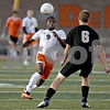 Monica Maschak - mmaschak@shawmedia.com<br /> DeKalb's Jandro Landa makes for a high ball in the first half of the Sycamore soccer match at DeKalb High School on Tuesday, September 24, 2013. DeKalb won 7-0.