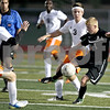 Monica Maschak - mmaschak@shawmedia.com<br /> Sycamore's Adam Millburg receives a pass in the first half of the Sycamore soccer match at DeKalb High School on Tuesday, September 24, 2013. DeKalb won 7-0.